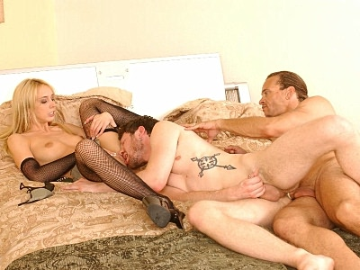 Hot big tit chick Kelly Wells loves having her pussy licked and with two hot bisexual hunks, she sure had her pink pussy munched on a lot. She spreads wide to get just that while another hot hunk is having his tight ass fucked hard from behind.video